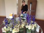 Lisa Christensen working on the banquet table centrepieces
